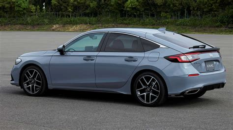 The hatchback version of the latest honda civic has been revealed, complete new 2022 honda civic saloon interior and infotainment. 2022 Honda Civic Hatchback Debuts With Sleek Look, Manual ...