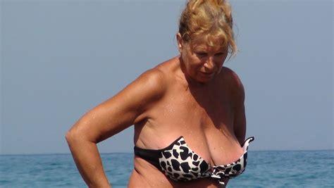 Busty granny on beach - PornHugo.Com