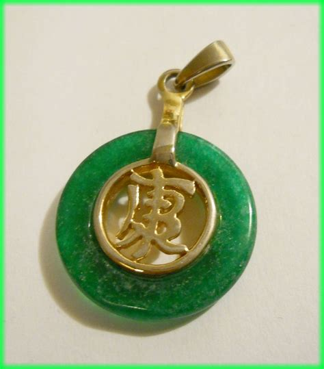 jade  gold pendant  chinese script marked