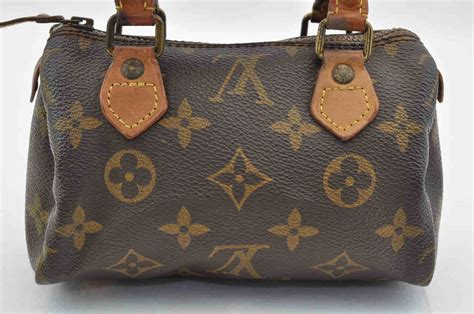 authentic louis vuitton monogram mini speedy hand bag