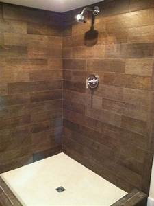 a lower level shower can have a warm welcoming feel when With bathrooms with wood tile floors