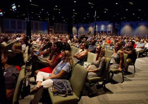 overflow crowd worships at fellowship in port st