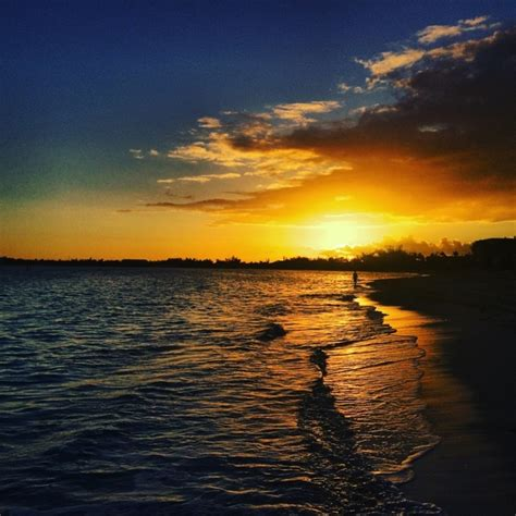 walk beach sunrise nassau bahamas photorator
