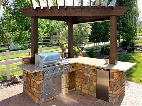 Outdoor Kitchen With A Barbecue And Bar Fridge. This Will