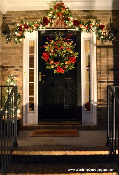 christmas decorated porches decorating with urns christmas edition amp up your holiday porch patio and curb appeal
