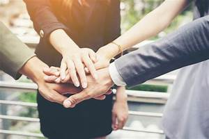 Close up of business people hands together. Teamwork ...