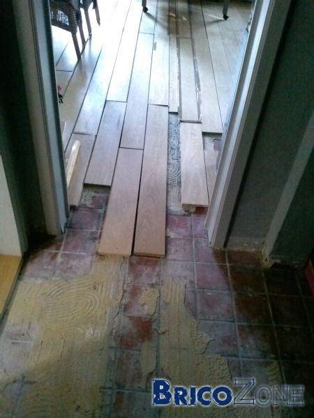 comment enlever la colle de plancher sur carrelage