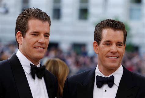 Winklevoss twins are bitcoin's first billionaires.) Winklevoss Twins: Facebook Cryptocurrency is 'Cool' But Bitcoin is Better