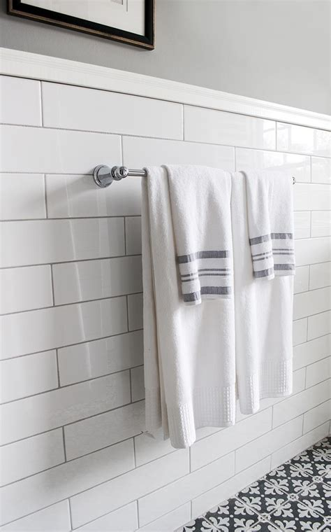 oversized subway tile  gray grout  skirting top