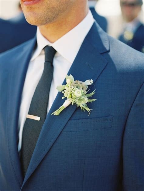 navy suit boutonniere  greenery