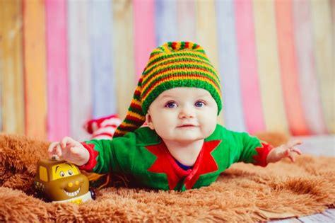 child dressed   elf lies  fluffy carpet  photo