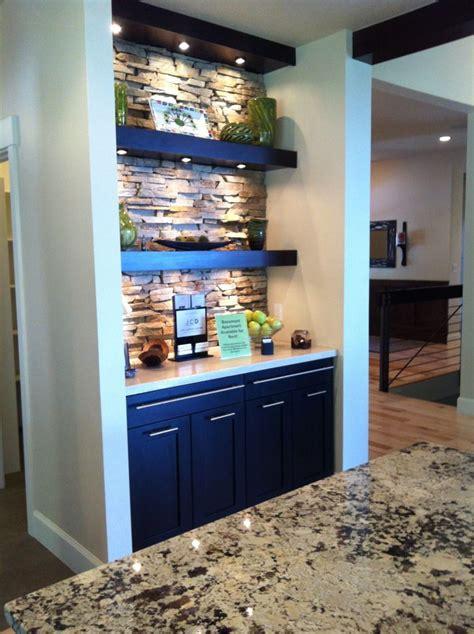 beautiful display area  kitchen  stone wall beautiful lit shelves modern cabinets