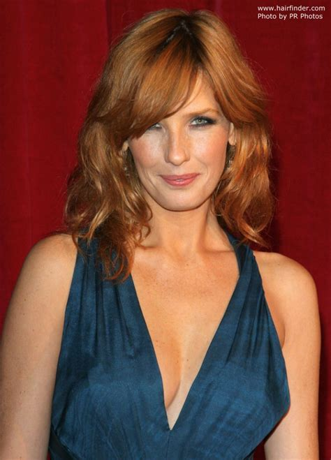 kelly reilly long layered hairstyle  brings