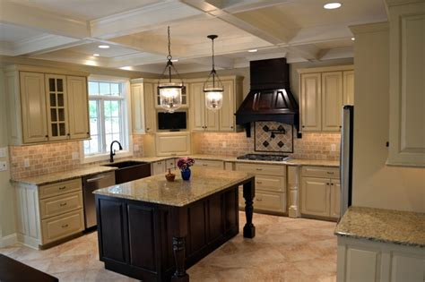 hanging kitchen cabinets distressed ivory kitchen accented by walnut island range 4146