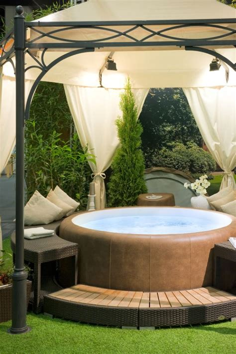 Whether your hot tub is on your deck or the middle of your yard, a gazebo can be an ideal enclosure. 31 Awesome Hot Tub Enclosure Ideas: #22 is the Coolest Ever!