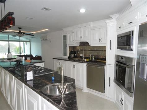 blue and green kitchen white kitchen cabinets with black and grey counter top 4800