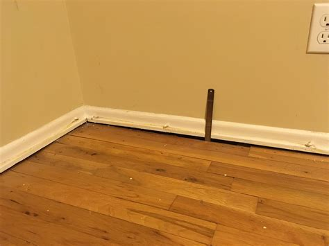repair   Half inch Gap between wall and floor in second
