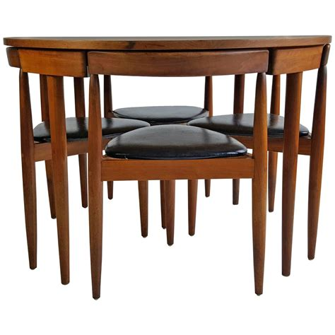 mid century modern dining table four chairs hans