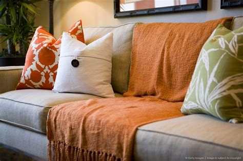Throws Blankets For Sofas by Comfortable Sofa With Orange Throw Blanket And Decorative