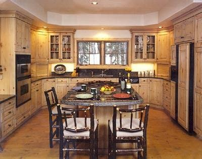 shaped rustic kitchen  large island cooktop