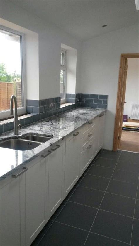 Viscount white granite with blue ice metro tiles   Kitchen