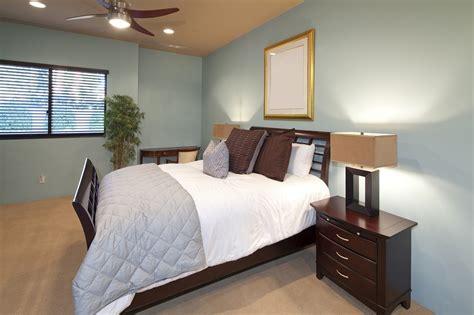 basic bedroom  cyan color walls propertylogy