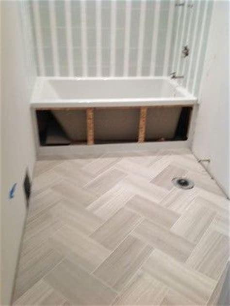 herringbone floor    porcelain tile   mud