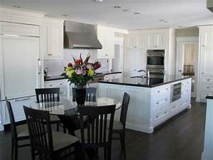dark floors white cabinets and black counters love it With best brand of paint for kitchen cabinets with white wall candle holders