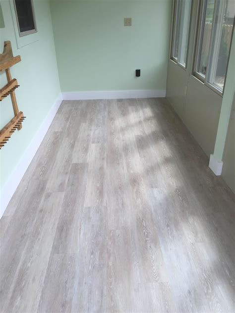 newly installed coretec plus flooring ivory coast oak in