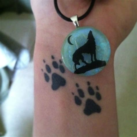 wolf paw tattoo images  pinterest wolf paw