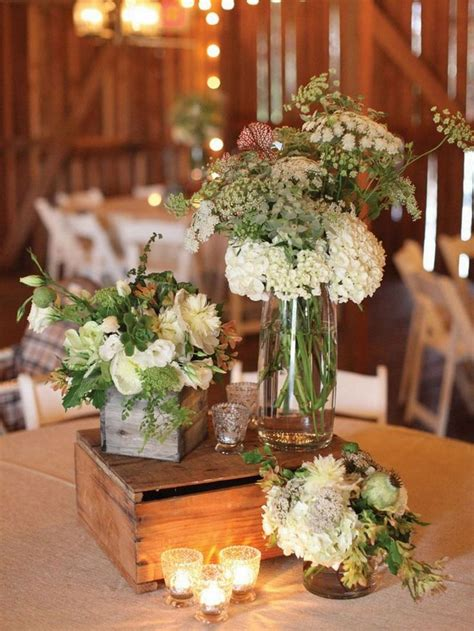 rustic table decorations rustic wedding table setting with wooden boxes and flower filled bottles weddings pinterest