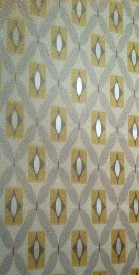 feature wall grey  mustard geometric print wallpaper