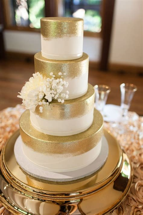 sparkly gold wedding cake  white flowers wedding
