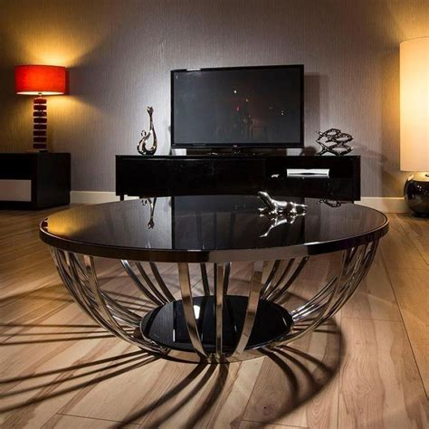 With a metal frame and a toughened glass top, this coffee table is perfect for a smaller living room and adaptable enough to work in any scheme. 30+ Amazing Glass Coffee Tables Ideas | Round glass coffee ...