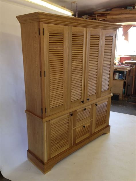 hand crafted media cabinet  louver doors  john