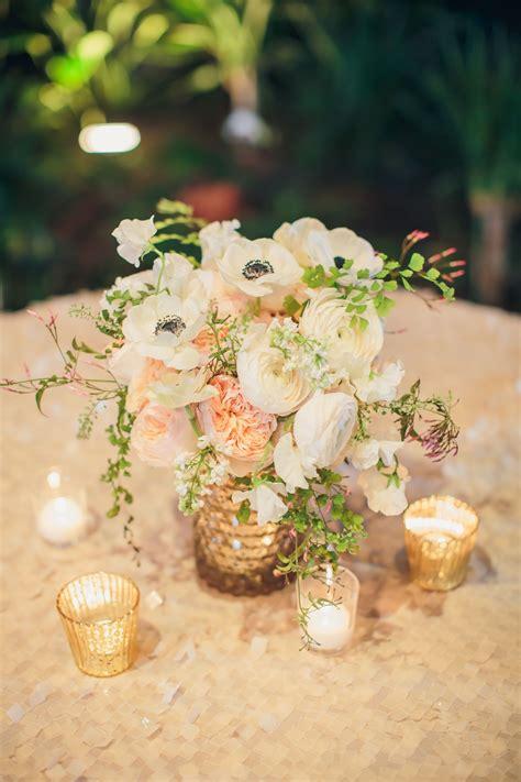 garden rose ranunculus  anemone centerpiece