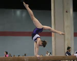 Gymnasts Doing Gymnastics On Beam