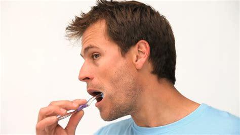 A Man Brushing His Teeth Stock Footage Video 1017226