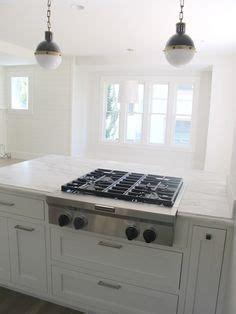 angled kitchen cabinets black gas stove top on white cambria quartz granite 1251