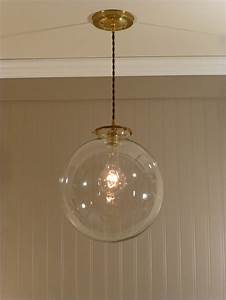 Brass pendant light with a inch clear glass globe