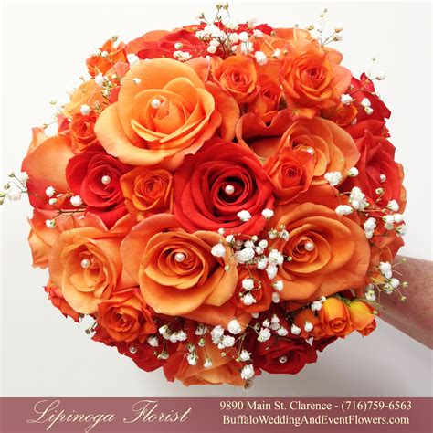 coral colored wedding centerpieces orange wedding flowers buffalo wedding event flowers