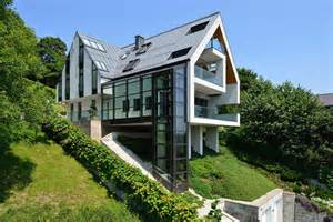 traumhaus designer gorgeous glass elevator connects levels on slope house