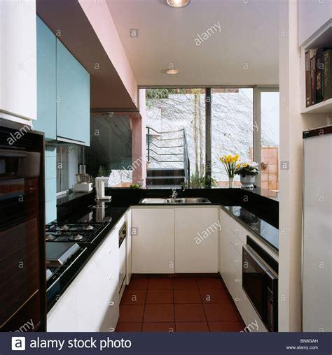 black galley kitchen modern galley kitchen with black worktops on white fitted 1681