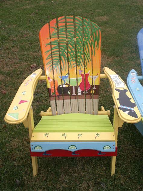 painted adirondack yellow chair yellow orange sunset with