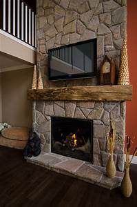 hand hewn barn beam mantels traditional living room With barn wood mantles