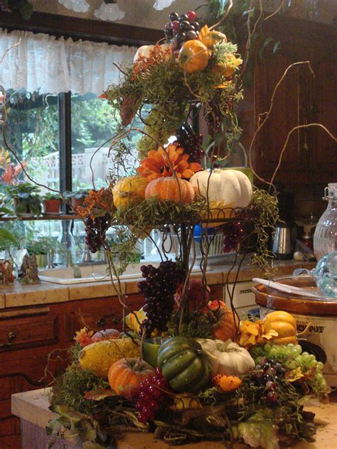 Fall Centerpiece Using Moss Twigs And Fall Vegetables And