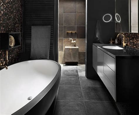 bathroom with black toilet a black hole moody bathroom design trends