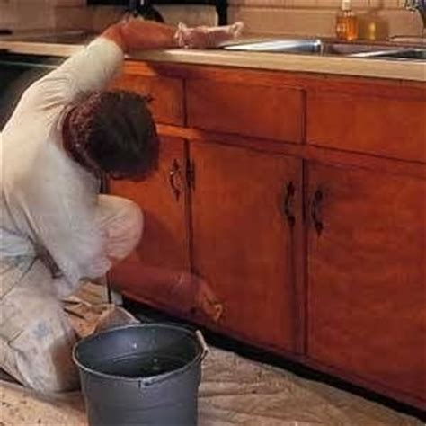 painting over stained cabinets how to paint over stained kitchen cabinets