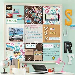 A beach inspired pinboard above dorm room desk adds