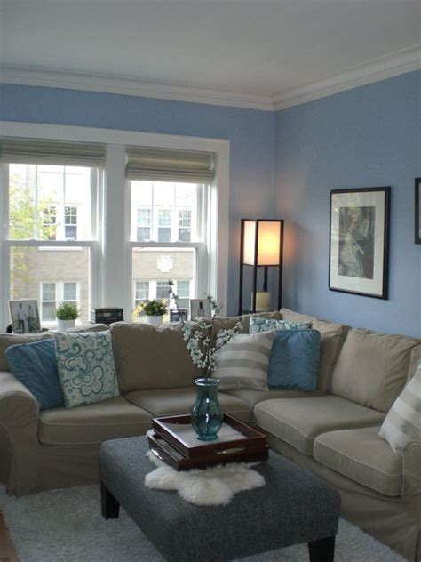 light blue walls  textiles   tan couch  refined